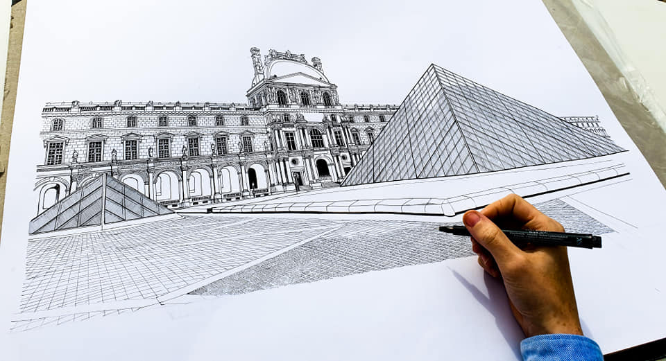Dessin en direct devant la Pyramide du Louvre.